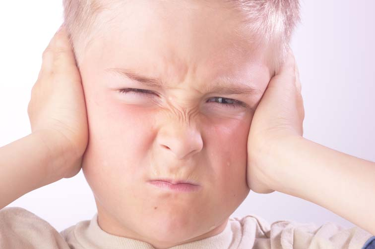 image boy holding head in pain, headache